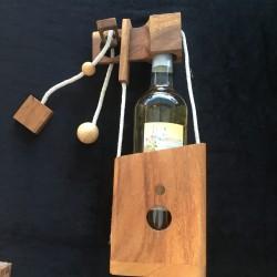 Le piège à bouteille en bois